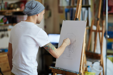 Young man drawing in art studio
